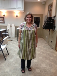 Debbie modeling her pretty striped apron