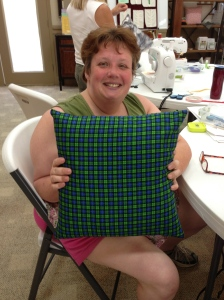 Heather's plaid zippered throw pillow