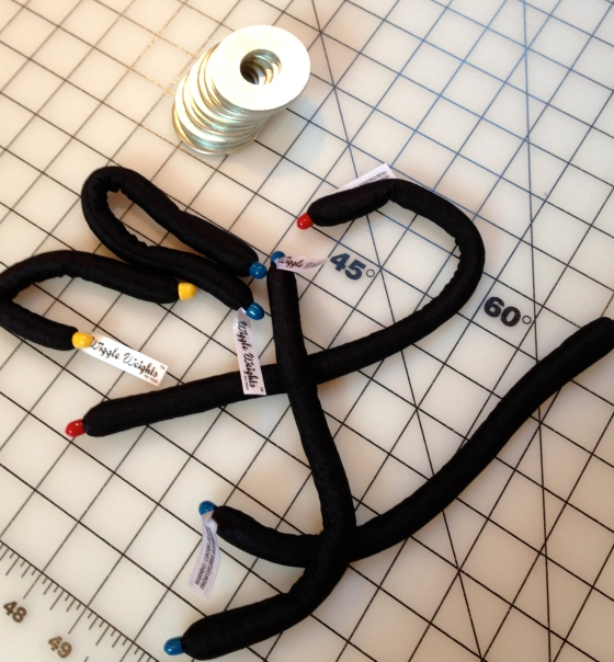 """Weights are used in place of pins, for a quick way to cut patterns from fabric.  Pictured here are 2"""" washers, available from hardware stores, and Wiggle Weights that I bought at Atlanta's Original Sewing and Quilting Expo last March."""