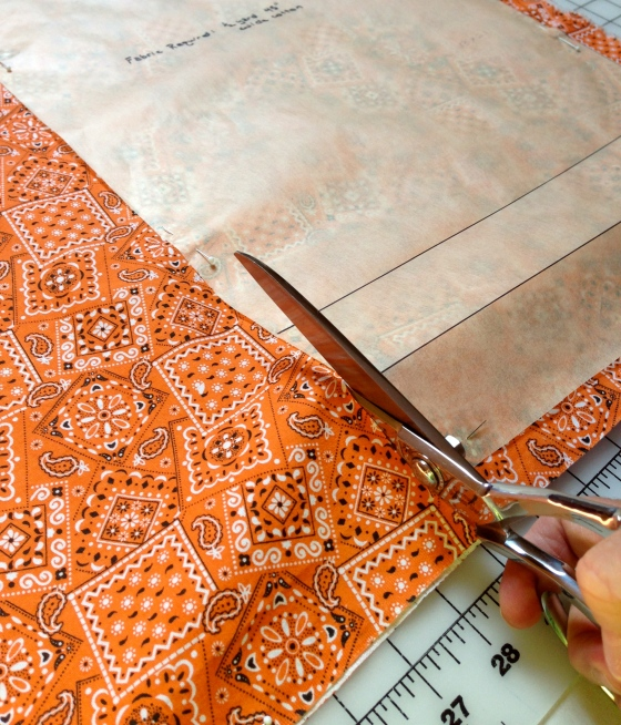 Angled Dressmaker's Shears make cutting out pattern pieces easier and more accurate.  The bottom  blade should be resting on the cutting surface.  If you are using a dining table, be sure to cover the surface with a protective layer of thick paper or a plastic cutting mat.