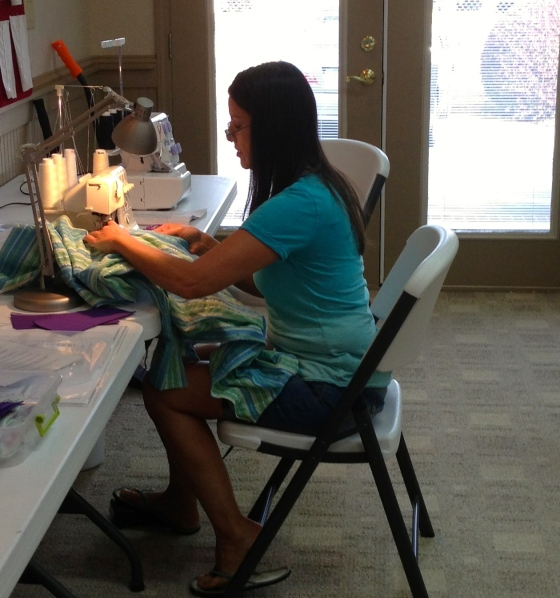 Dana trying out the serger